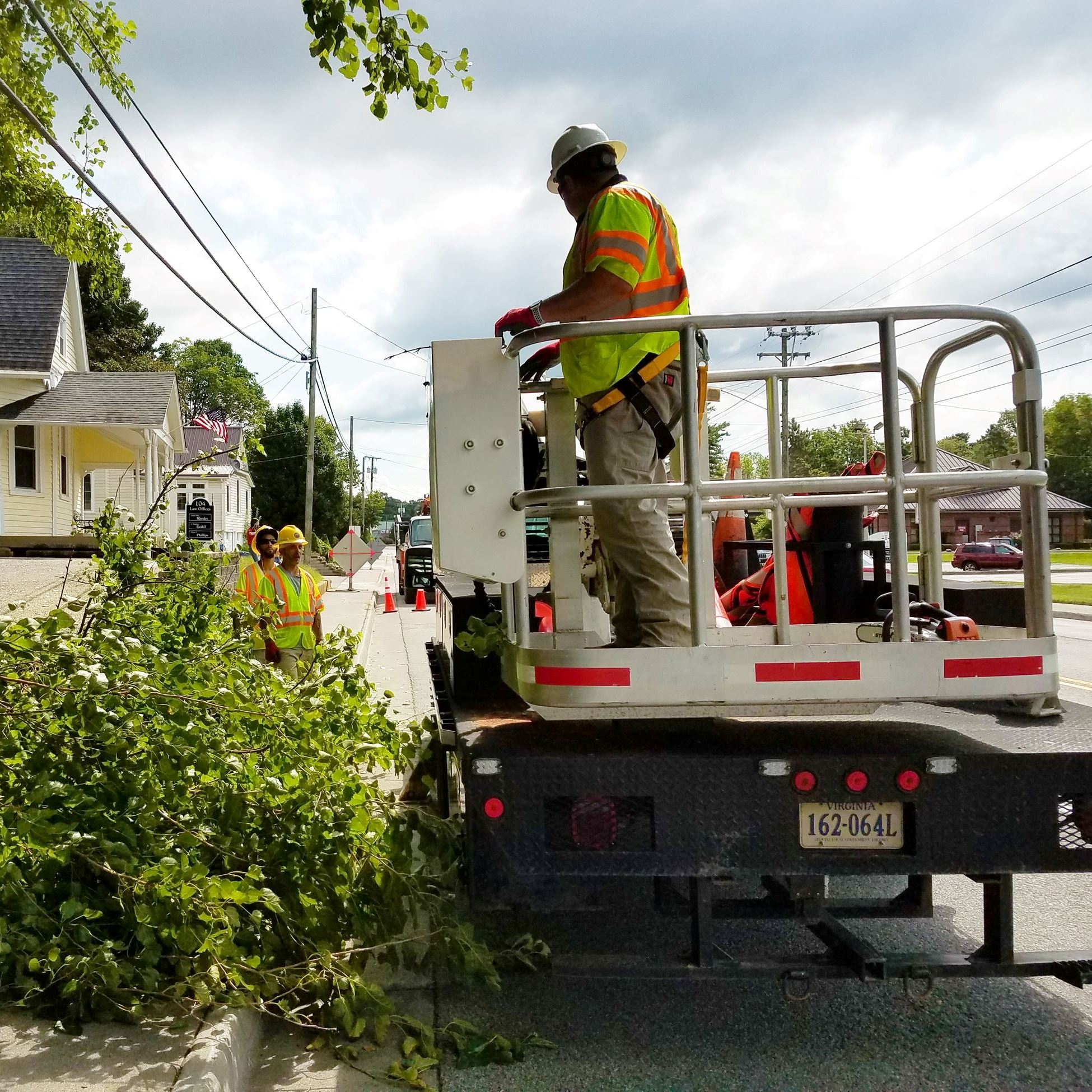 A Town employee wearing a hard hat and Public Works vest.