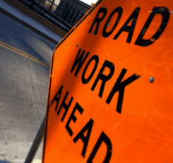 "Orange ""road work ahead"" sign"