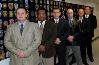 CID Detectives Nolen, Brown, Townley, Spence, Moye, and Lt. Bonds. Detective Jones not pictured.